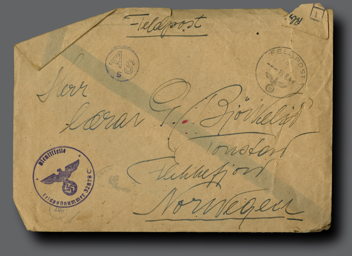 "Envelope marked ""fieldpost"", a name and adress in handwriting and postmarks."