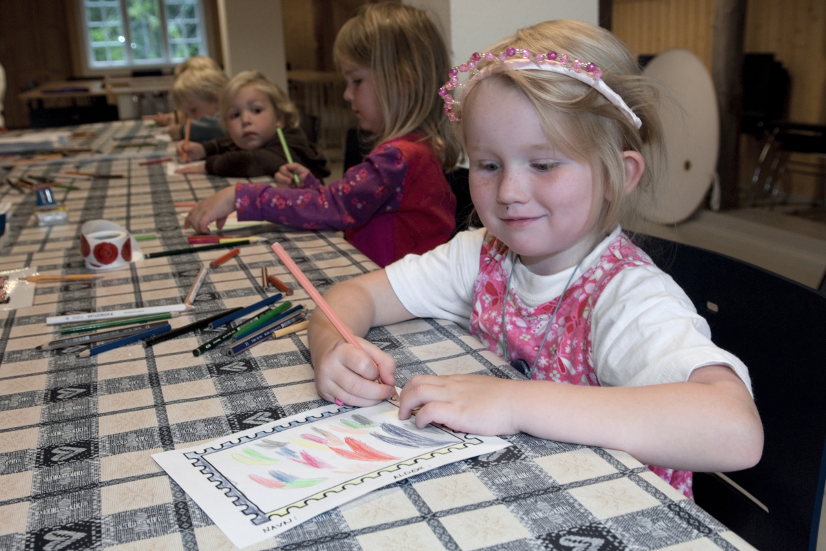 Girl drawing at the Norwegian Postal Museum at Maihaugen in Lillehammer in Norway.